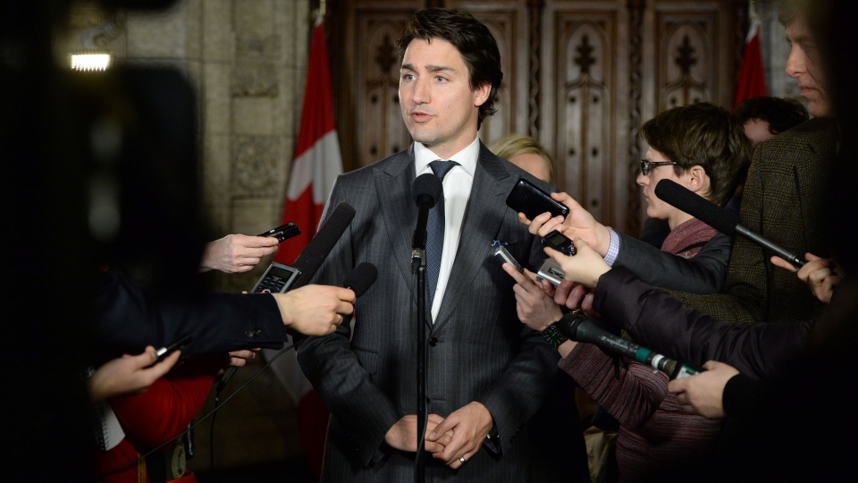 Liberal leader Justin Trudeau speaks to reporters in the foyer of the House of Commons on Parliament Hill in Ottawa on Tuesday, Feb. 25, 2014. (Sean Kilpatrick / THE CANADIAN PRESS)
