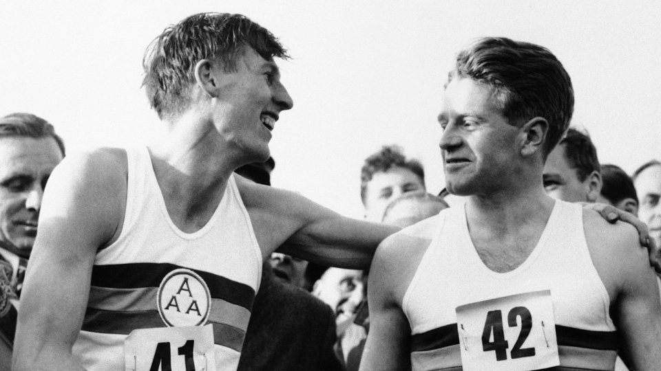 This is a May 6, 1954, file photo of Roger Bannister, left, who ended the quest for the four-minute mile, with a time of 3:59.4 at Oxford, England is congratulated by pacemaker Christopher Chataway. (AP Photo, File)