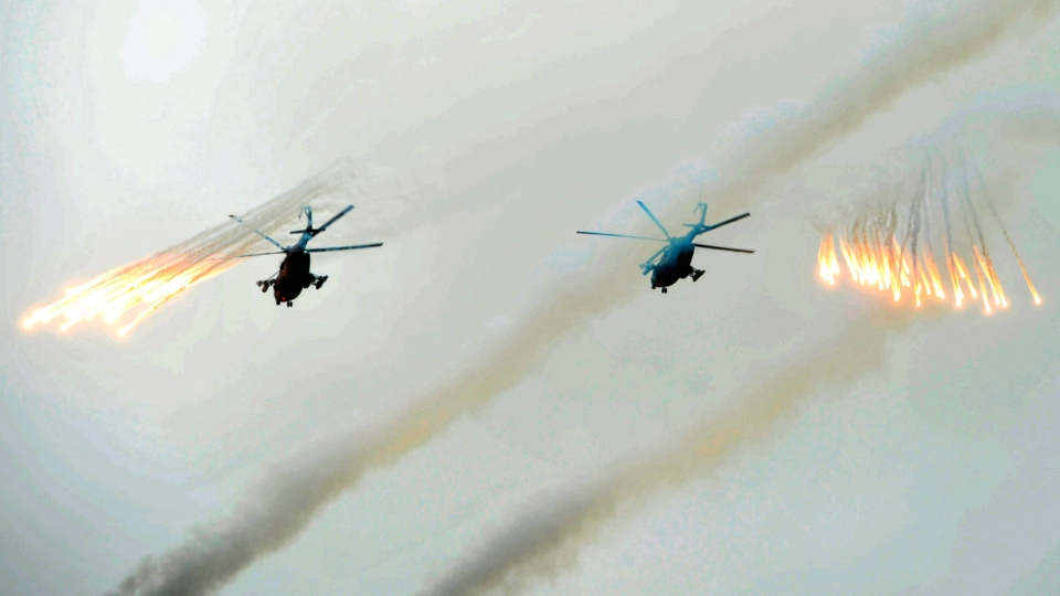 Russian Army helicopters fire flares during military exercises on Tuesday, July 16, 2013. (RIA Novosti / Alexei Nikolsky)