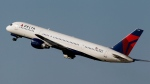 A Delta Airlines Boeing 757 is seen taking off on Jan. 20, 2011. (AP / Chris O'Meara)