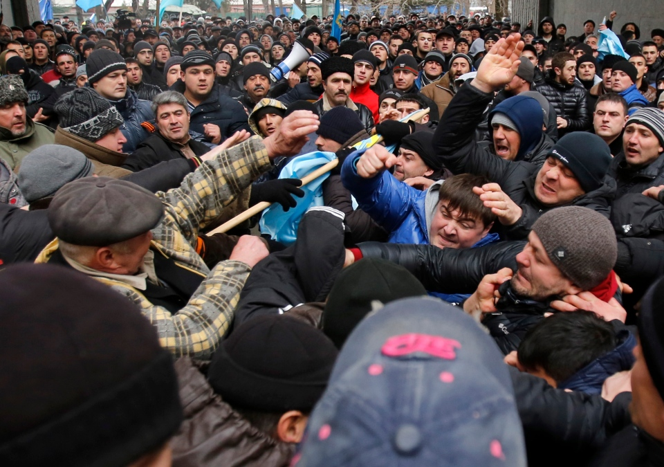 Pro-Russian protesters, right, clash with Crimean Tatars in front of a local government building in Simferopol, Crimea, Ukraine, Wednesday, Feb. 26, 2014. (AP / Darko Vojinovic)