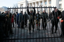 Anti-Yanukovych protesters remove a fence