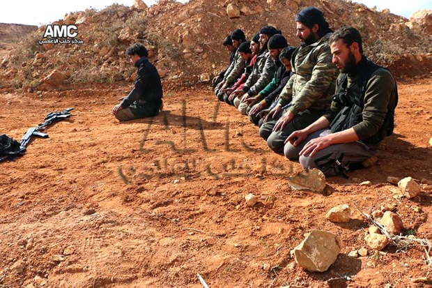 Syrian rebels pray on frontlines