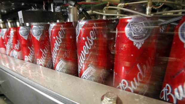 Budweiser cans run through a filling machine at the Anheuser-Busch brewery in the Van Nuys area of Los Angeles is seen Wednesday, March 2, 2011. (AP Photo/Reed Saxon)