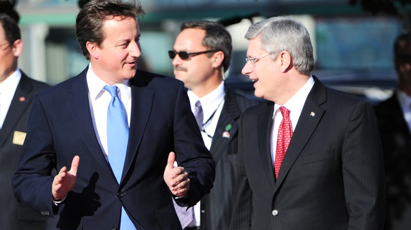 British Prime Minister David Cameron arrives in Ottawa