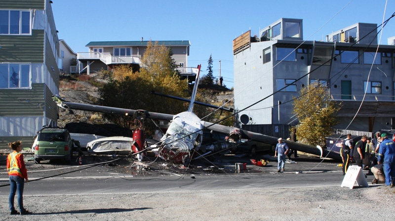 Emergency workers attend the scene of a plane crash in Yellowknife on Thursday Sept. 22, 2011. (John Doody / THE CANADIAN PRESS)