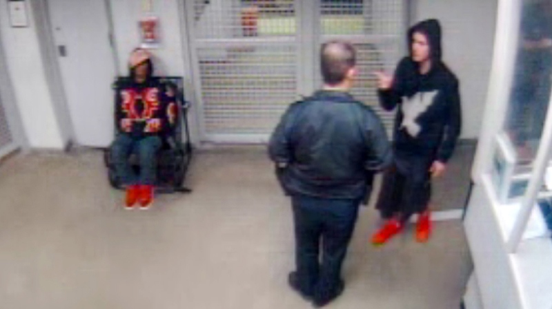 In this Jan. 23, 2014 video frame grab released by the Miami Beach Police Department, Justin Bieber, right, gestures to a police officer while under arrest in Miami Beach, Fla. (AP Photo/Miami Beach Police Dept. HO)