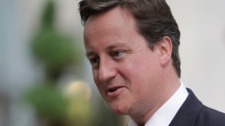david cameron heading to canada to talk to mps