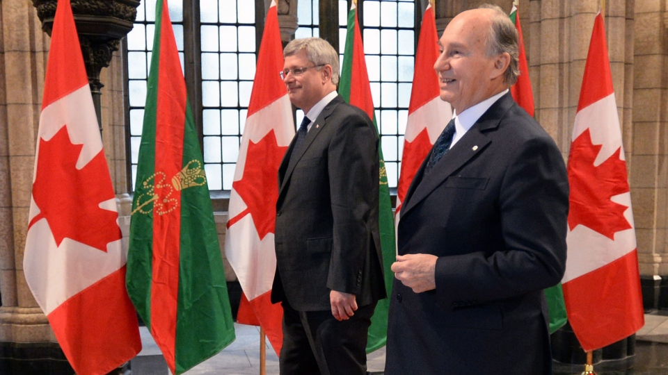 Prime Minister Stephen Harper welcomes the Aga Khan, spiritual leader of the Ismaili Muslims, to Parliament Hill in Ottawa on Thursday, Feb. 27, 2014. (Sean Kilpatrick / THE CANADIAN PRESS)