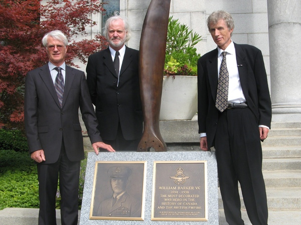 Alec, David and Ian Mackenzie, from left to right, grandsons of Canadian flying ace William Barker, pose at a ceremony unveiling a monument in Barker's honour at a Toronto cemetery, Thursday, Sept. 22, 2011. (Pat Hewitt / THE CANADIAN PRESS)