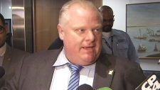 Toronto Mayor Rob Ford speaks with reporters