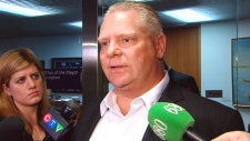 Coun. Doug Ford speaks with reporters