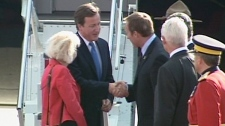 British Prime Minister shakes hands with Defence Minister Peter MacKay upon his arrival in Ottawa on Thursday, Sept. 22, 2011.