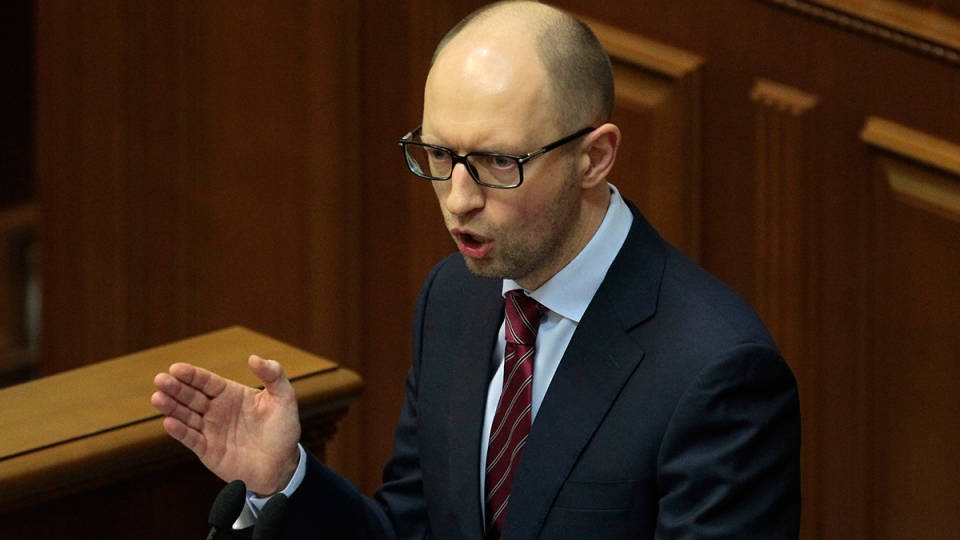 New Ukrainian Prime Minister Arseniy Yatsenyuk speaks to lawmakers during a session at the Ukrainian parliament in Kyiv, Thursday, Feb. 27, 2014. (AP / Sergei Chuzavkov)