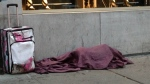 A homeless man sleeps in downtown Montreal. (Jean-Luc Boulch/CTV Montreal)