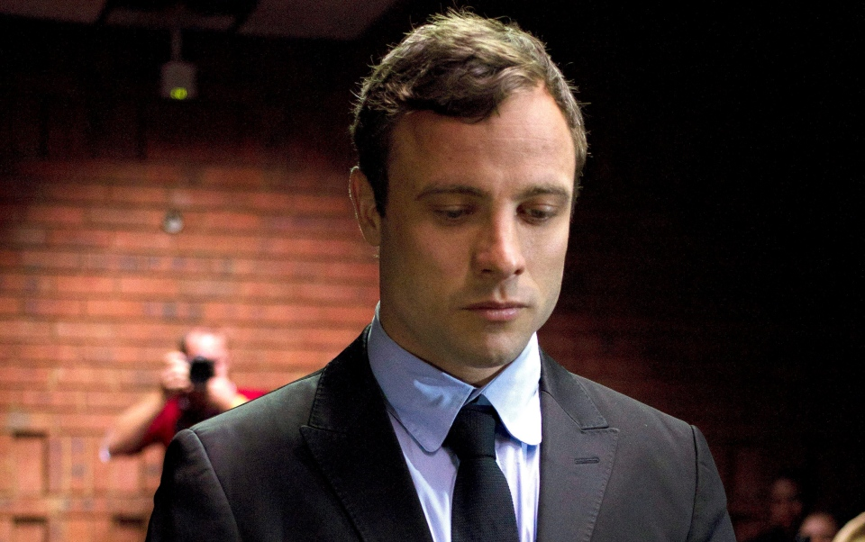 Double-amputee Olympian Oscar Pistorius appears at the magistrates court to be indicted on charges of murder and illegal possession of ammunition for the shooting death of his girlfriend on Valentine's Day in Pretoria, South Africa on Monday, Aug. 19, 2013. (AP / Themba Hadebe)