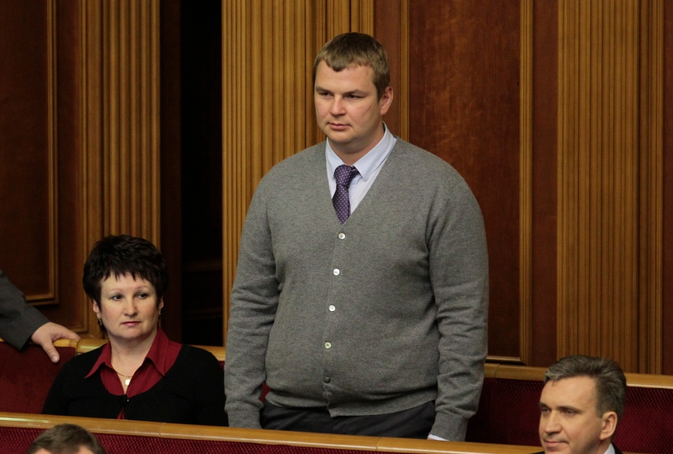 Protest leader Dmytro Bulatov stands in Parliament after being appointed Youth and Sports Minister in Kiev, Ukraine, Thursday, Feb. 27, 2014.  (AP / Sergei Chuzavkov)