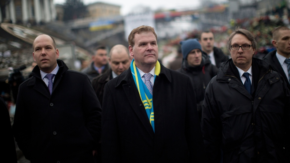 Minister of Foreign Affairs John Baird, center, walks in Independence Square, the epicenter of the country's current unrest in Kyiv, Ukraine, Friday, Feb. 28, 2014. (AP / Emilio Morenatti)