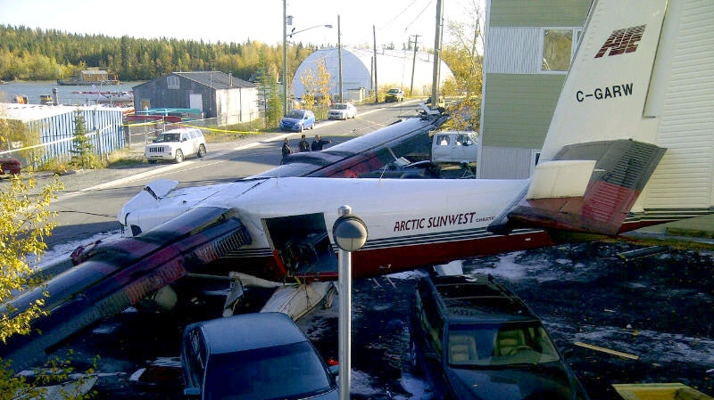 Wreckage of an Arctic Sunwest plane crash that claimed the lives of two people and injured seven others in Yellowknife on Thursday Sept., 22, 2011.