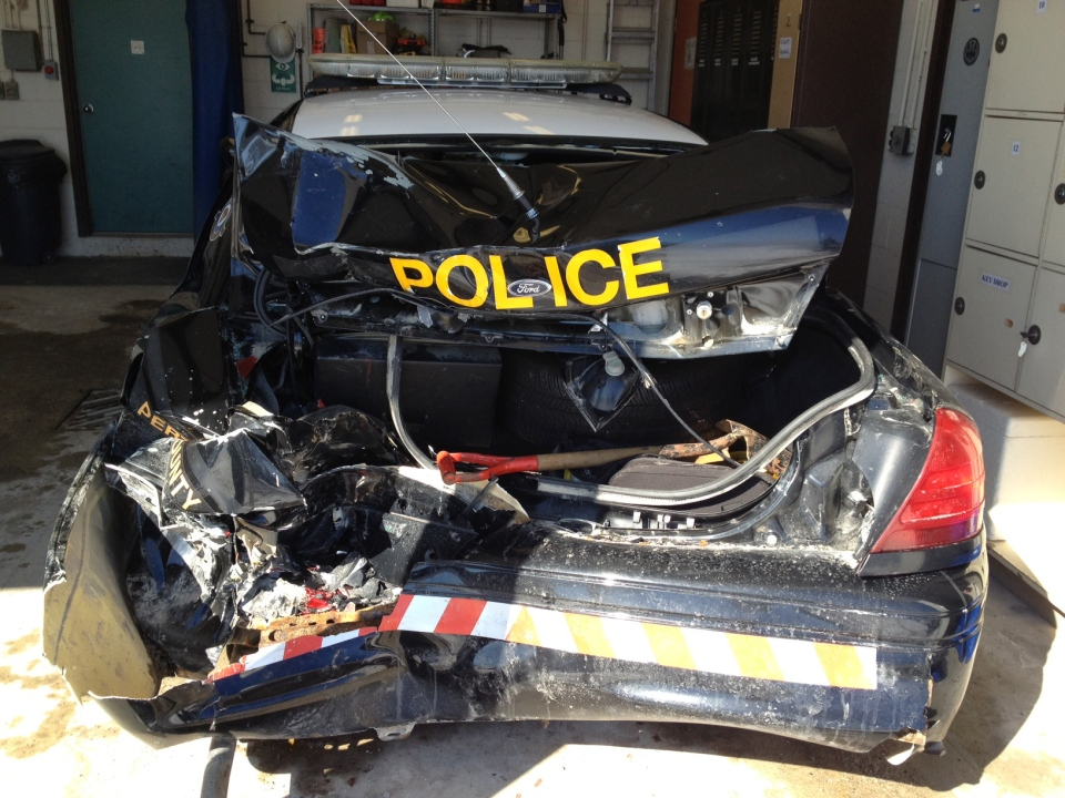 An OPP cruiser destroyed when a pickup truck slammed into it during stormy weather is seen in Sebringville, Ont., on Friday, Feb. 28, 2014. (Abigail Bimman / CTV Kitchener)