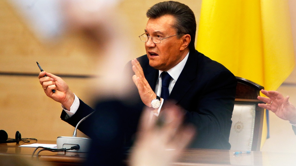 Ukraine's fugitive President Viktor Yanukovych speaks at a news conference as journalists raise arms to ask questions in Rostov-on-Don, a city in southern Russia about 1,000 kilometres from Moscow, Friday, Feb. 28, 2014. (AP / Pavel Golovkin)