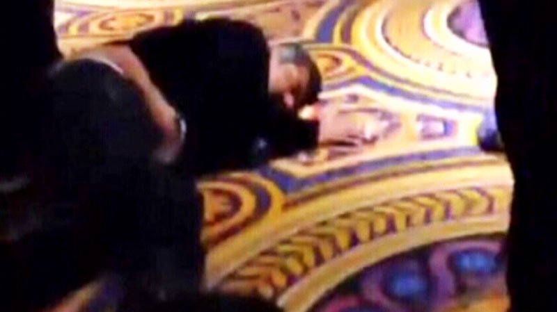 In this unauthenticated photo, George Lopez appears to be passed out on a carpet on Thursday, Feb. 27, 2014. (@ChadMaura /  Twitter)