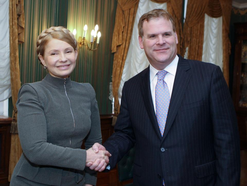 Former Ukrainian Prime Minister Yulia Tymoshenko shakes hands with Canada's Minister of Foreign Affairs John Baird in Kyiv, Ukraine, Friday, Feb. 28, 2014. (AP / Olexander Prokopenko)