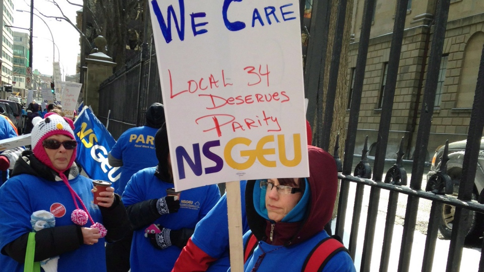 Striking home care workers marching outside Nova Scotia legislature in Halifax on Friday, Feb. 28, 2014. (Michael Tutton / THE CANADIAN PRESS)