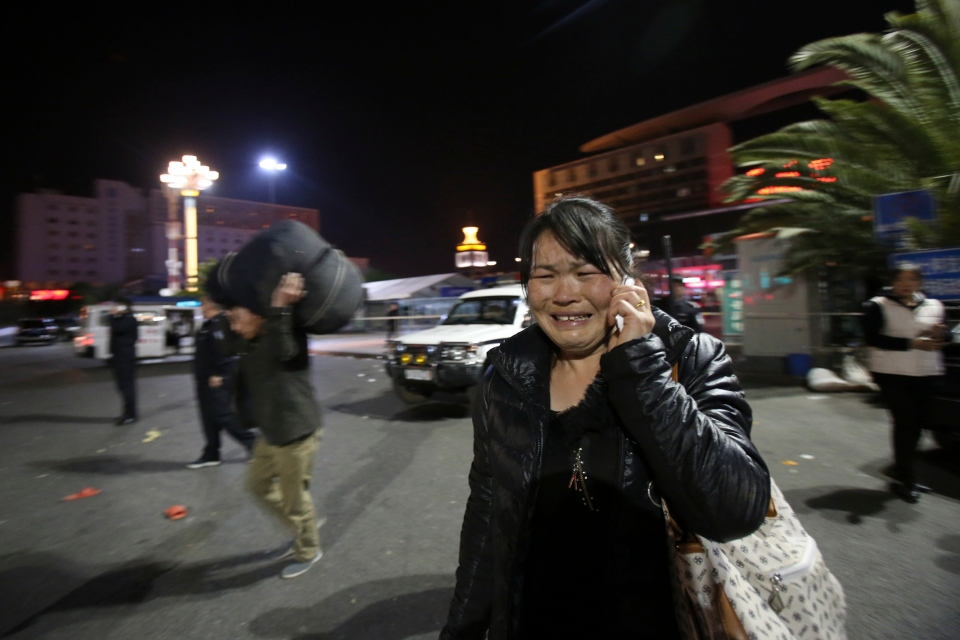 A woman reacts at the crime scene outside a railway station in Kunming, in southwestern China's Yunnan province, on March 1, 2014. (AP Photo)