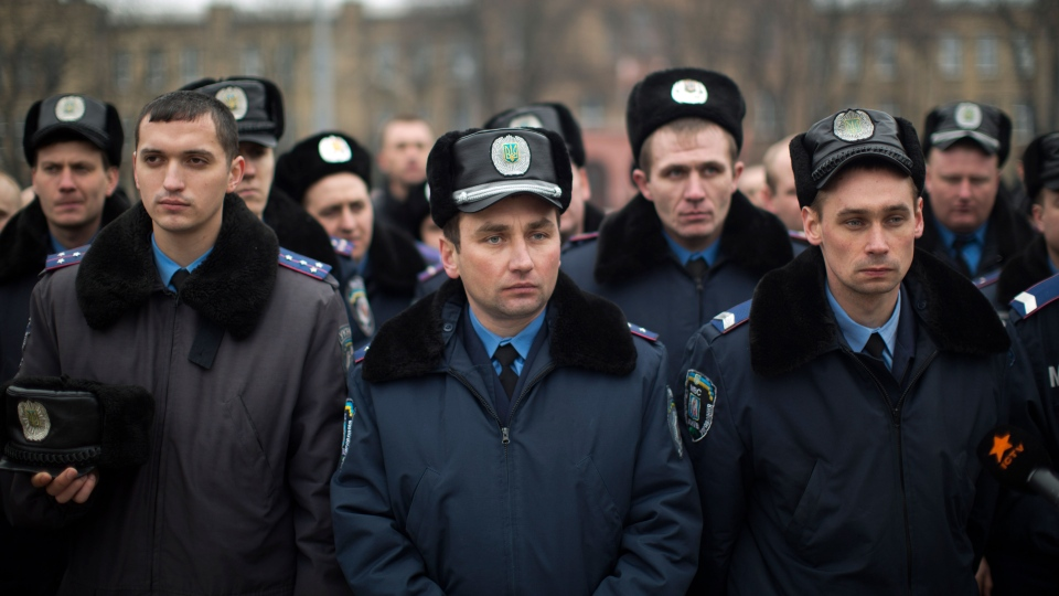 Ukrainian police officers attend a rally to pay their respects for people killed during the latest clashes at the Independence Square in Kyiv, Ukraine, Saturday, March 1, 2014. (AP / Emilio Morenatti)