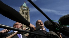 NDP leadership candidate Brian Topp talks to reporters on Parliament Hill
