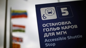 A sign indicating a shuttle stop for people with disabilities stands in Olympic Park in Sochi, Russia, at the 2014 Winter Olympics on Tuesday, Feb. 18, 2014. (AP Photo/David Goldman)