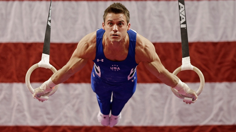 Sam Mikulak performs on the rings during the American Cup gymnastics competition in Greensboro, N.C., Saturday, March 1, 2014. Mikulak won the men's overall title. (AP Photo/Chuck Burton)