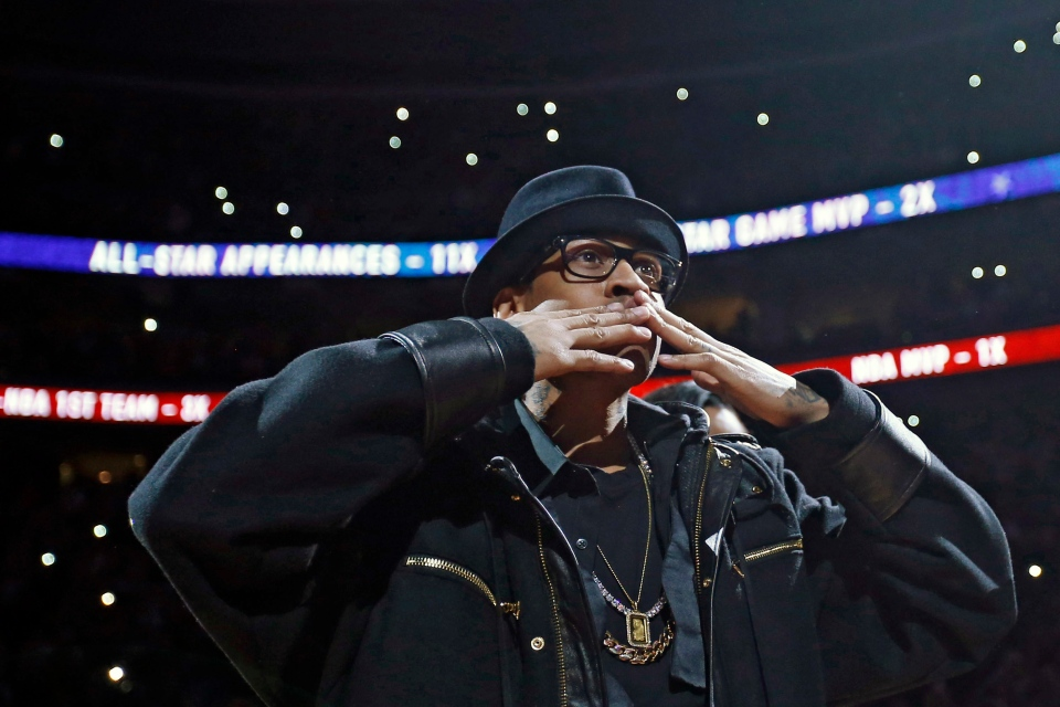 Former Philadelphia 76ers' Allen Iverson blows a kiss to the crowd during a retirement ceremony at half-time of an NBA basketball game between the Philadelphia 76ers and the Washington Wizards in Philadelphia, Saturday, March 1, 2014. (AP / Matt Slocum)