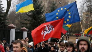 Demonstrators gather outside the Russian Embassy in Vilnius, Lithuania, to protest against Russian intervention in Ukraine Sunday, March 2, 2014. (AP / Mindaugas Kulbis)