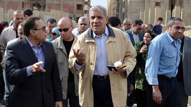 Egypt PM urges end to strikes