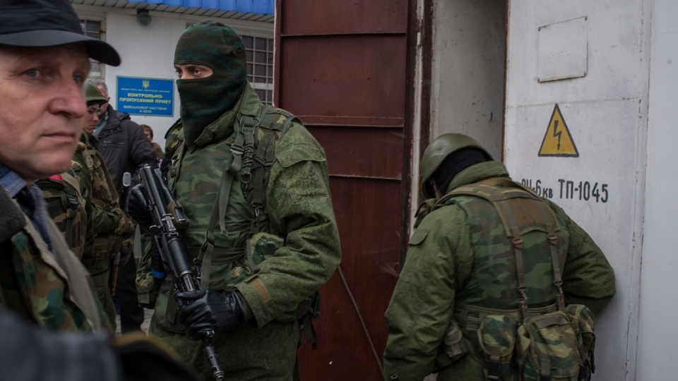 A group of armed unidentified gunmen cut electric power to General Headquarters of the Ukrainian Naval forces in Sevastopol,Ukraine Sunday, March 2, 2014. (AP / Andrew Lubimov)
