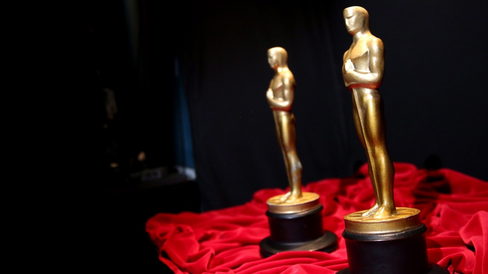 A pair of prop Oscars are seen backstage during rehearsals for the 86th Academy Awards in Los Angeles, Friday, Feb. 28, 2014. The Academy Awards will be held at the Dolby Theatre on Sunday, March 2. (Photo by Matt Sayles / Invision / AP)