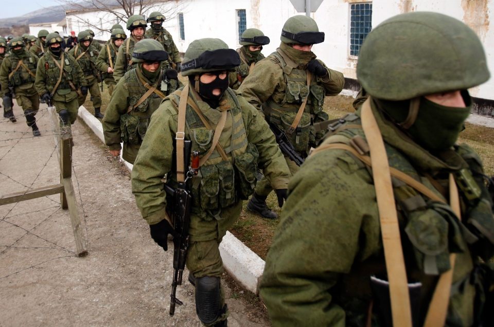 Unidentified armed men patrol around a Ukraine's infantry base in Perevalne, Ukraine on March 2, 2014. (AP / Darko Vojinovic)