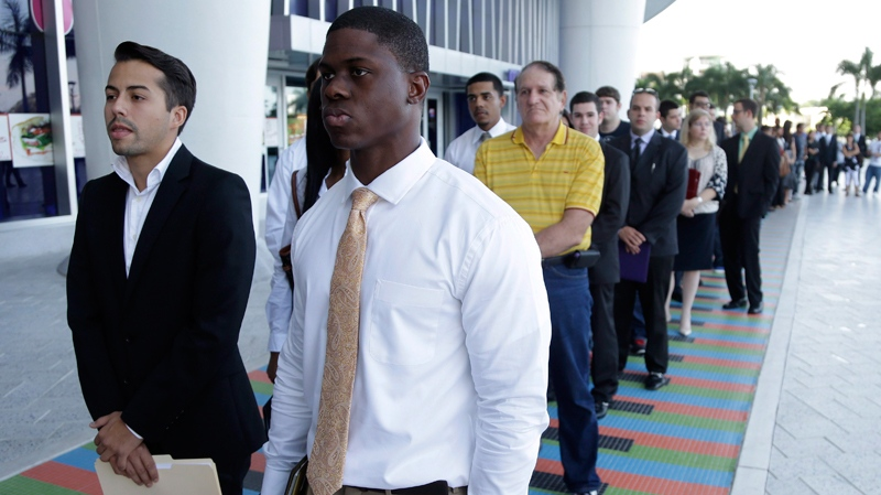 In this Wednesday, Oct. 23, 2013 file photo, hopefuls wait in line at an internship job fair held by the Miami Marlins, at Marlins Park in Miami. (AP Photo/Lynne Sladky, File)