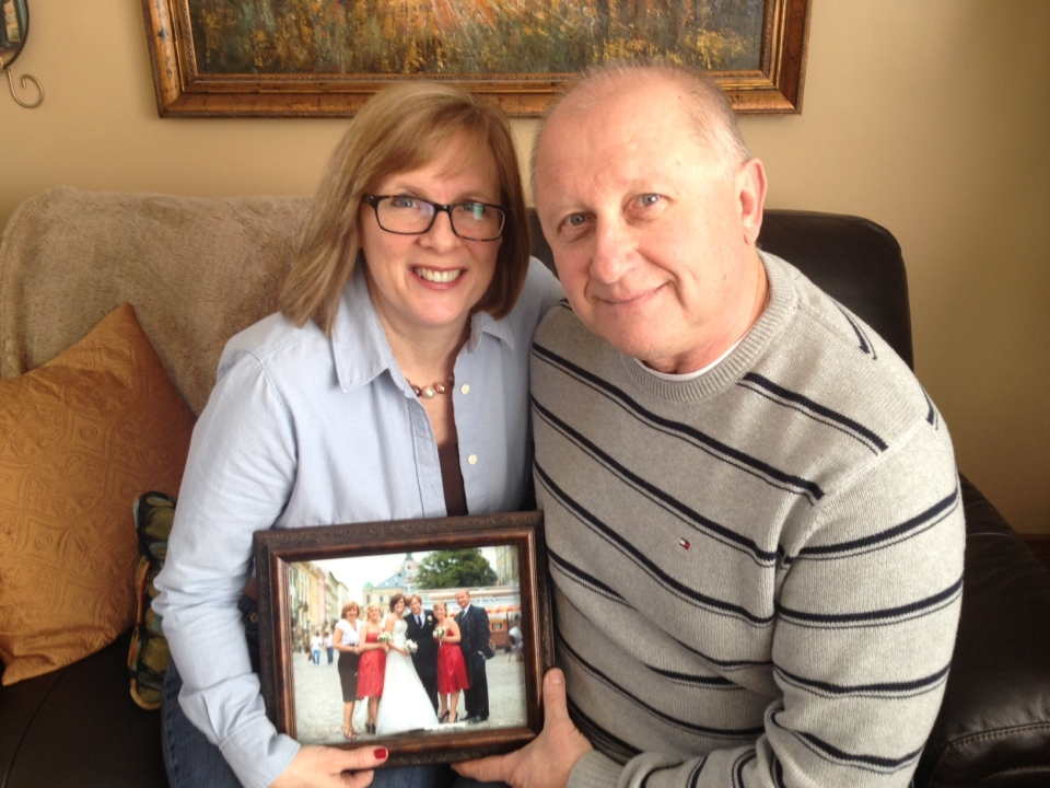 Walter and Ruth Semeniuk of Waterloo hold a wedding photo of their son Johnny, who lives and works in Kyiv.  Photo Courtesy: Marc Venema