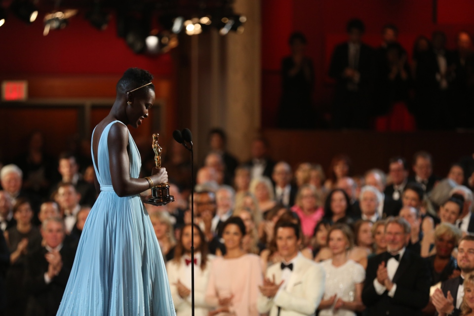 Lupita Nyong'o accepts the award for best actress in a supporting role for '12 Years a Slave' during the Oscars at the Dolby Theatre on Sunday, March 2, 2014. (Matt Sayles / Invision)