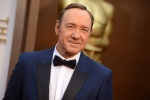Kevin Spacey arrives at the Oscars at the Dolby Theatre in Los Angeles, Sunday, March 2, 2014. (Jordan Strauss / Invision)