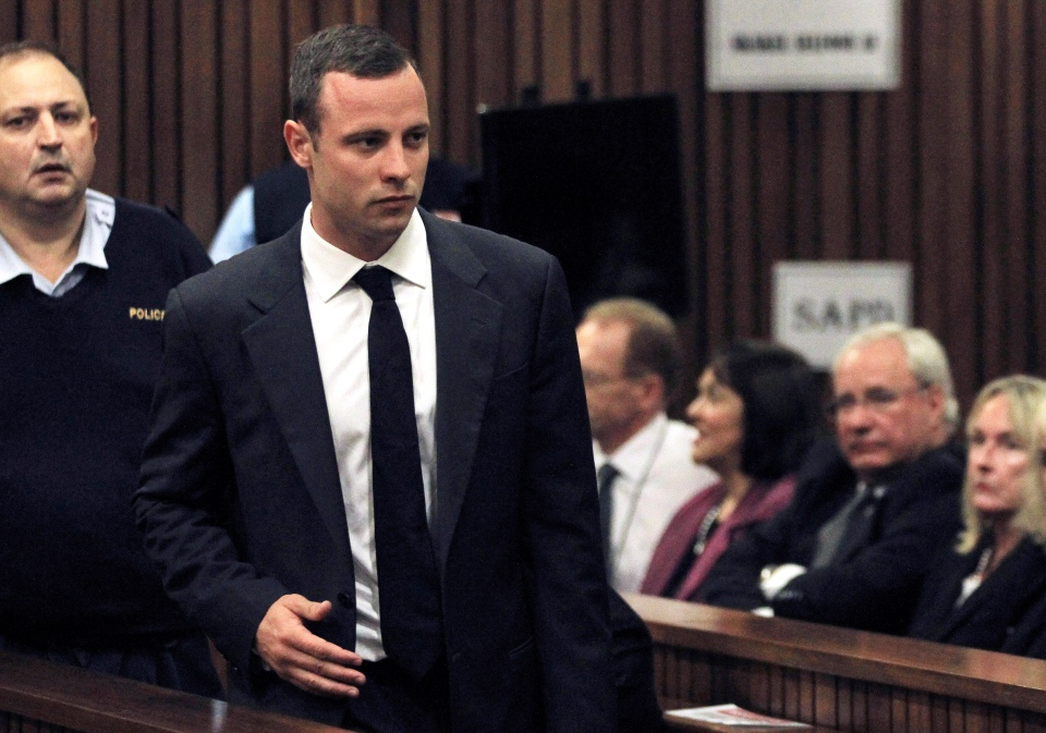 Oscar Pistorius is watched by June Steenkamp, right, the mother of Reeva Steenkamp, as he arrives for his trial at the high court in Pretoria, South Africa, Monday, March 3, 2014. (AP / Themba Hadebe)
