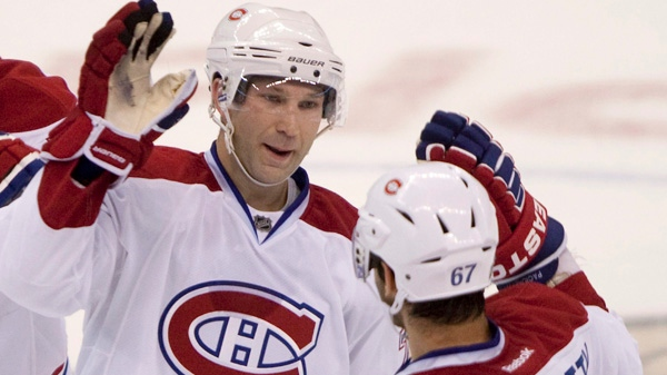 Montreal Canadiens' Max Pacioretty congratulates Erik Cole, left, on his shootout game winning goal against the Ottawa Senators during period pre-season NHL action in Ottawa, Friday September 23, 2011. THE CANADIAN PRESS/Adrian Wyld