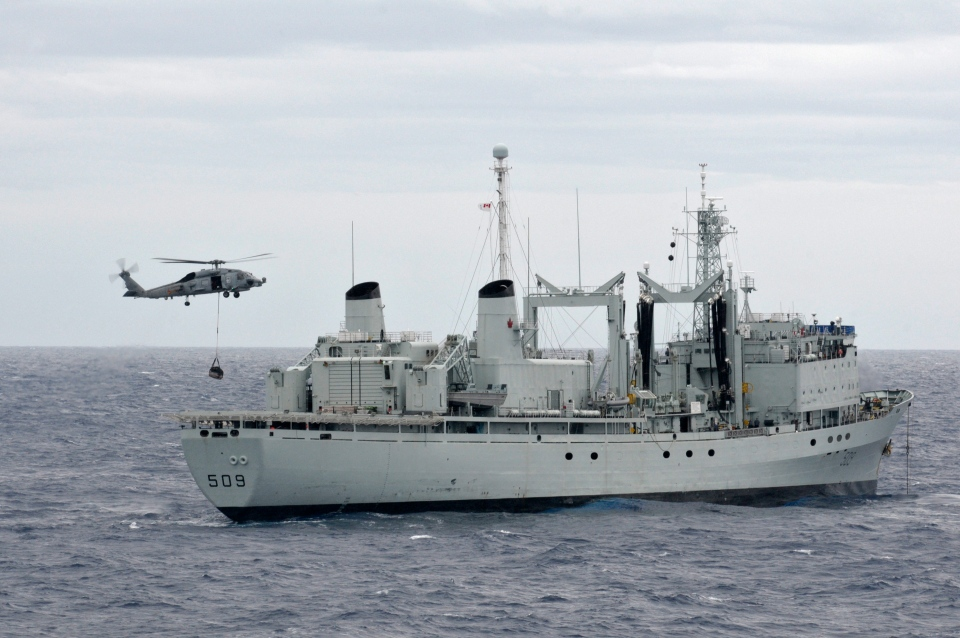 An SH-60B Sea Hawk helicopter prepares to load materials aboard the Royal Canadian Navy auxiliary oil replenishment ship HMCS Protecteur, Saturday, March 1, 2014. (U.S. Navy / Mass Communication Specialist 3rd Class Johans Chavarro)