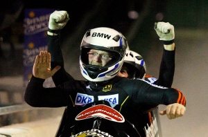 Germany's Manuel Machata, front, and his teammates celebrate winning the four-man World Cup bobsled event in Calgary, Alta., on Feb. 11, 2012. (Jeff McIntosh/THE CANADIAN PRESS)