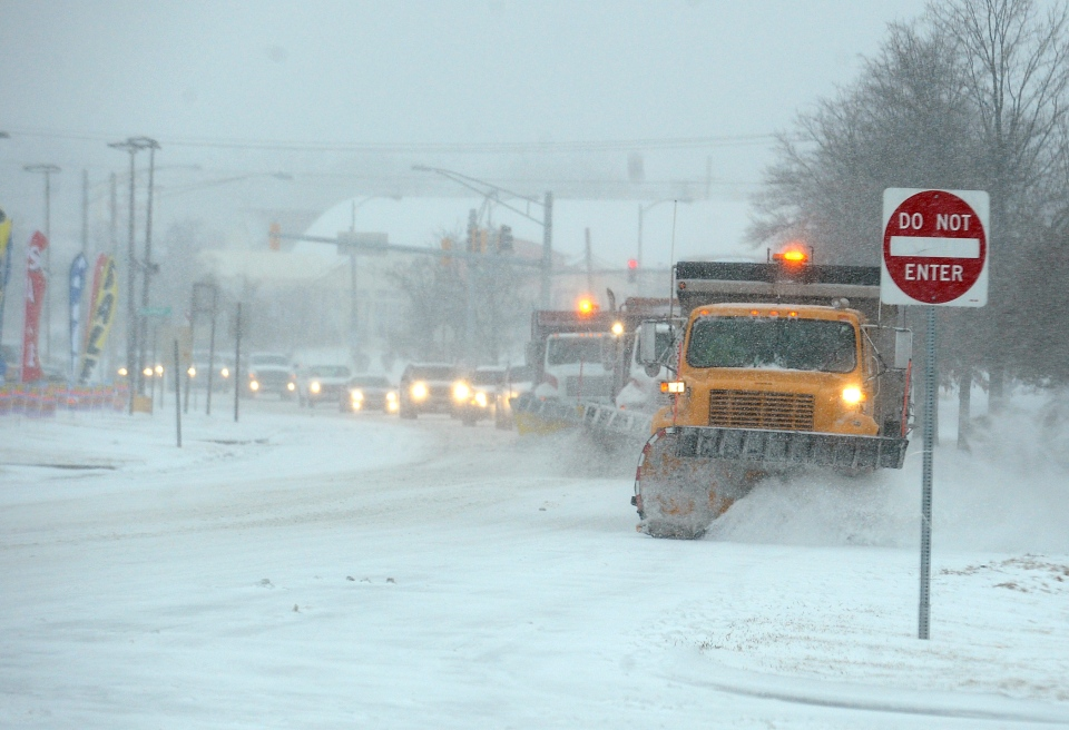 Snow plows work on Ritchie Highway near Route 648 in near Glen Burnie, Md. on Monday, March 3, 2014. (Capital Gazette / Paul W. Gillespie)
