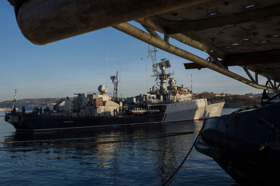 People stand aboard the Ukrainian navy corvette Ternopil as it stands at harbour in Sevastopol, Ukraine on March 3, 2014. (AP / Andrew Lubimov)