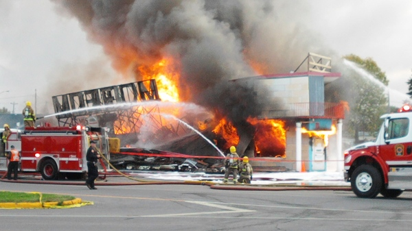 MyNews contributor Sean Miller snapped this photo of the Miss Dorion blaze in Vaudreuil early Sunday morning. The building is a write-off.